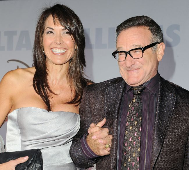 "FILE - This Nov. 9, 2009 file photo shows actor Robin Williams, right, and  his wife Susan Schneider at the premiere of ""Old Dogs"" in Los An..."