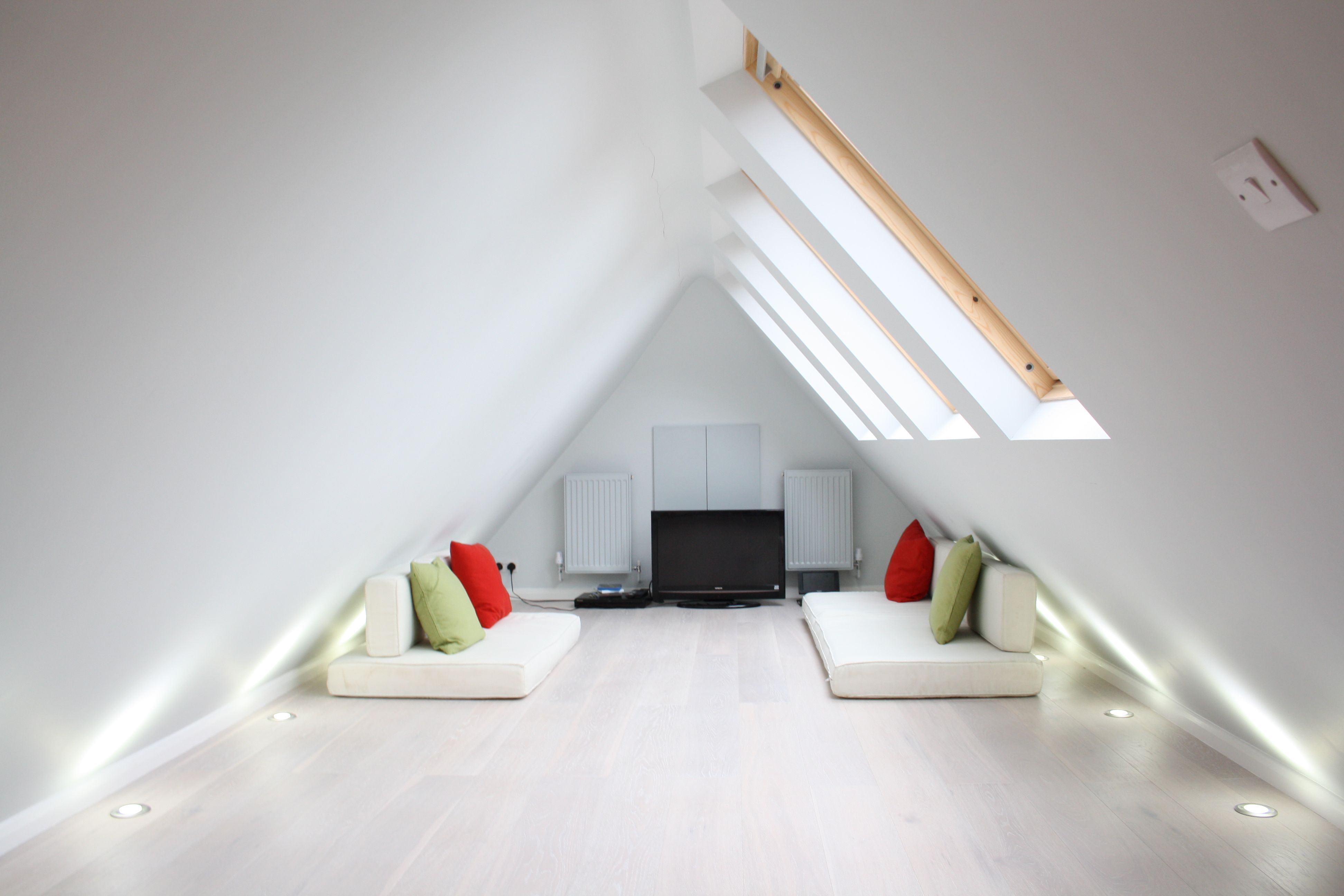 Loft conversion cinema room hide away in north west london by simply loft what to do in the - Small loft space model ...