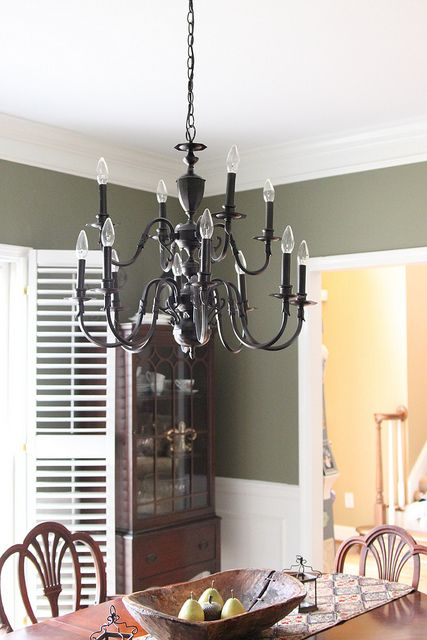 Let There Be (Non-Brassy) Light! ~ Revive those tacky '90s brass light fixtures with 'Rust-oleum Oil Rubbed Bronze Spray Paint' and a little elbow grease. The difference in the look of the light fixture is astounding...understated and elegant. Wonder how this would work on those ugly brass door knobs and more?!