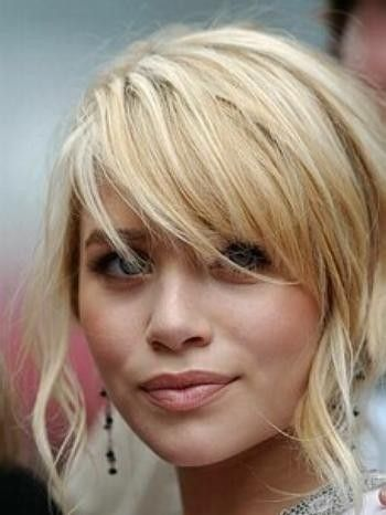Thick, layered hair with sideswept bangs - easy to maintain, and they still look great & wispy even as they're growing out