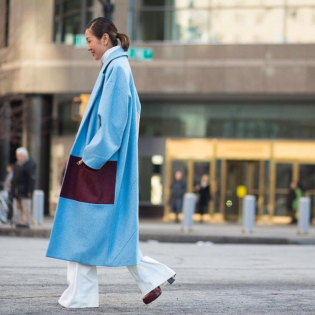 """""""This street style spot is ticking a trifecta of new season trends with her color-block coat, coordinating burgundy platforms and white flared pants.…"""""""