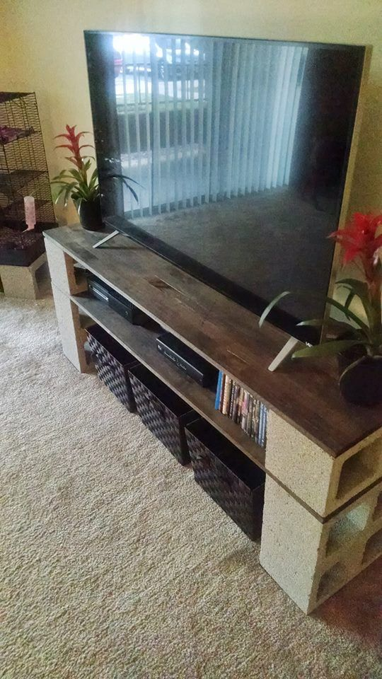 My homemade rustic/industrial tv stand project, turned out pretty good. :)  Cinder blocks, 2 cut boards from home depot & then stained with a cloth. :)