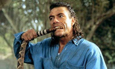 Dude doesn't need to bite a rattlesnake to prove how bada$$ he is. The mullet does all the talking for him.