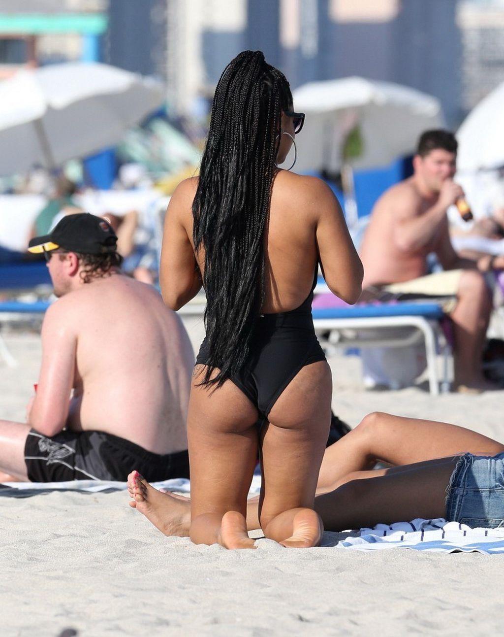 christina milian at a miami beach. the beautiful songstress also had