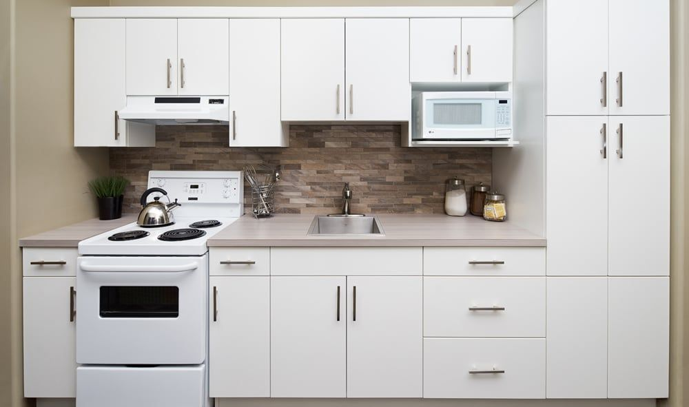 Soho White Cabinets Calgary   Townhouse designs, Cabinet ...