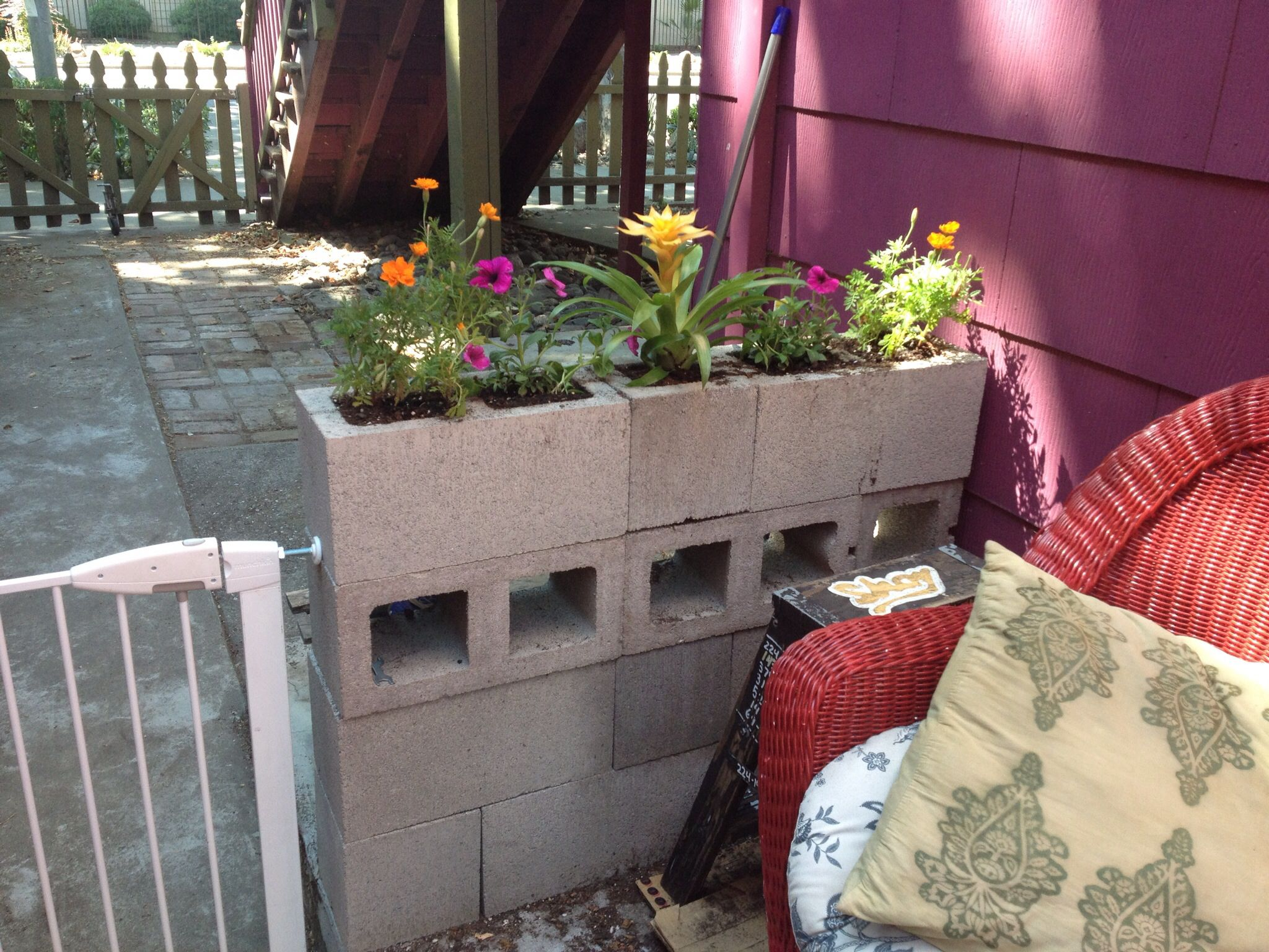 Self built concrete wall with flower bed.