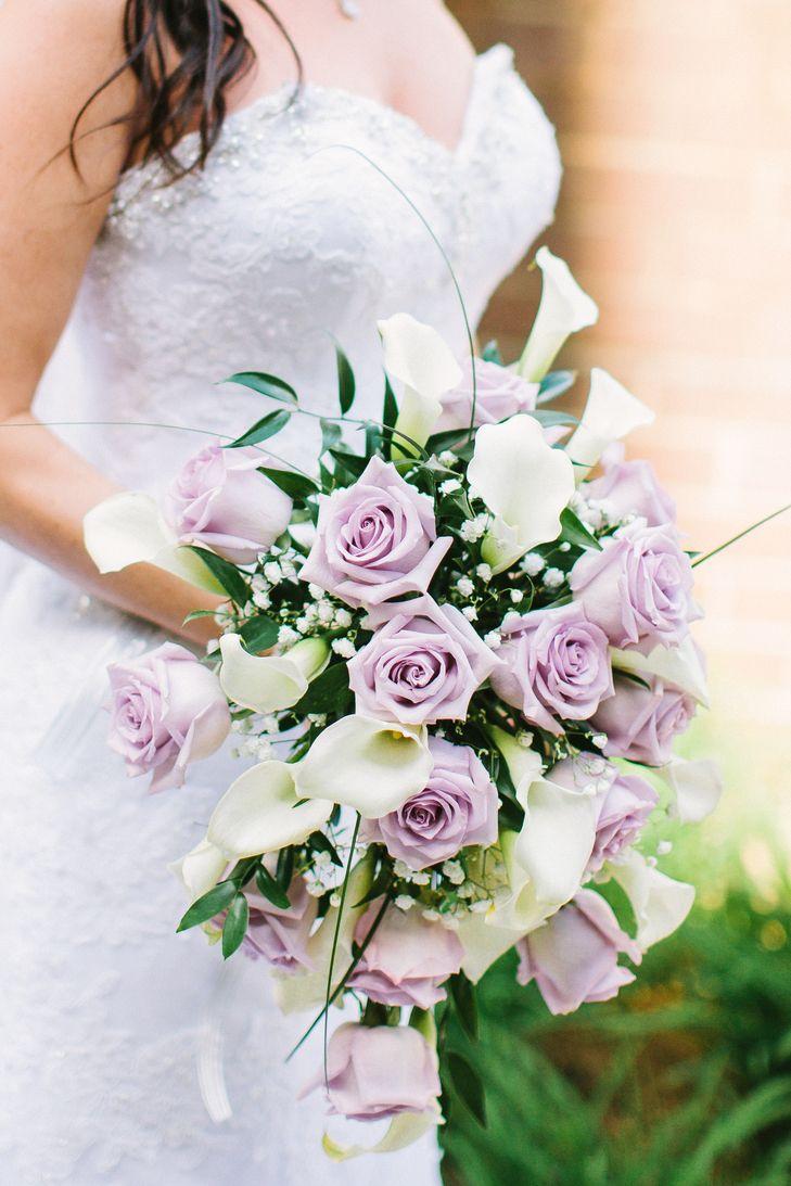 Brides beautiful bouquet which includes lavender roses white brides beautiful bouquet which includes lavender roses white calla lilies white gypsophila izmirmasajfo
