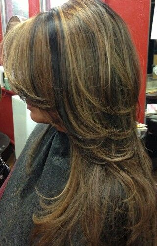 Long layered dark hair with caramelized highlights