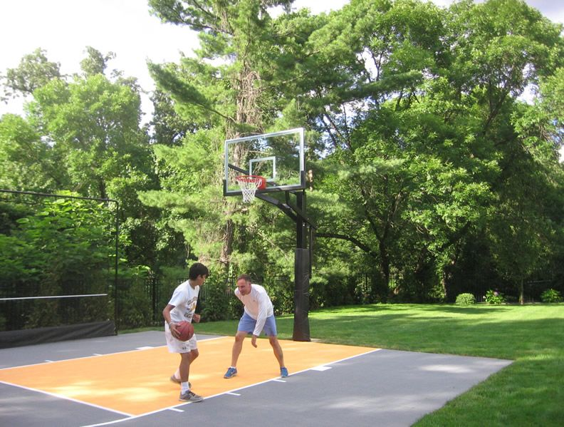 Joe Deshayes And His Son Enjoy Some Family Time On A Backyard Basketball Court Built By Basketball Court Backyard Outdoor Basketball Court Backyard Basketball