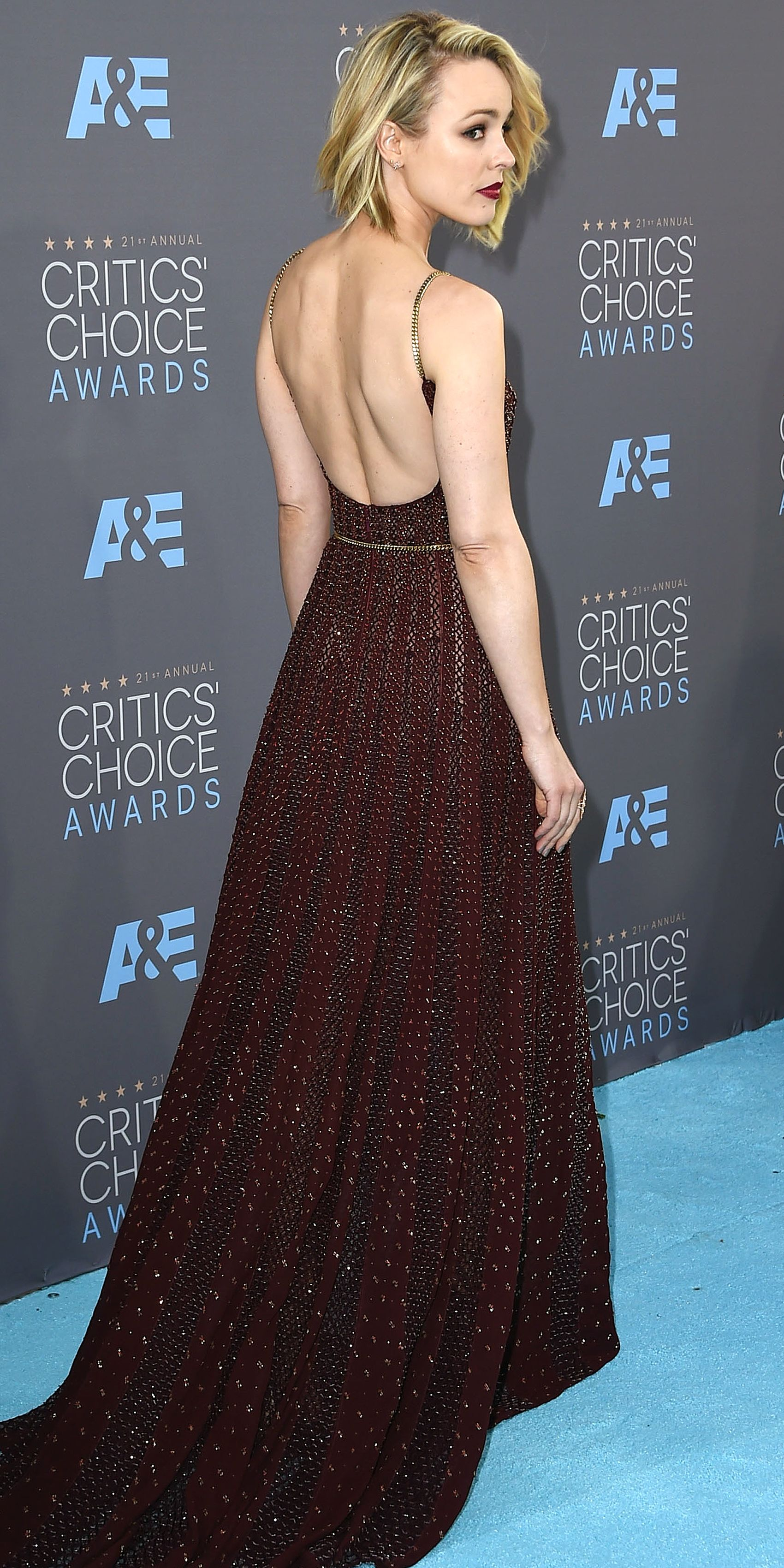 RACHEL MCADAMS wears an Elie Saab gown with delicate golden-chain straps and belt, plus Graziela Gems studs, to the Critics' Choice Awards.