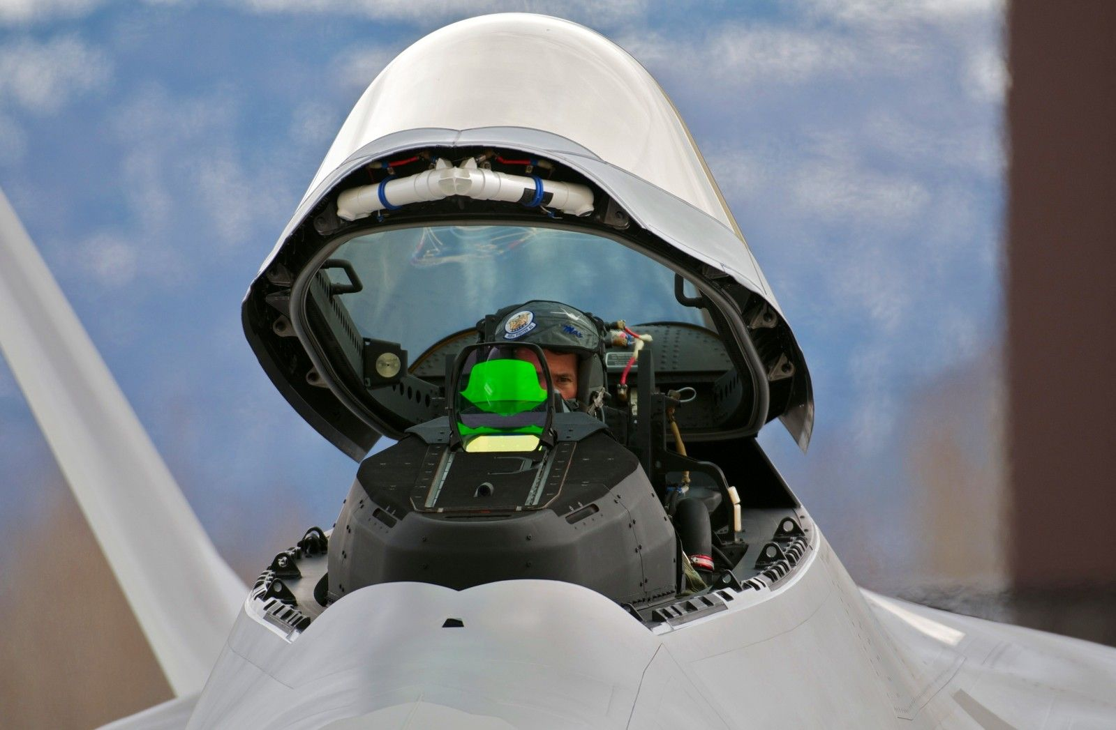 Paul Moga 525th Fighter Squadron commander raises the canopy of the Air Forceu0027s last delivered F-22 Raptor fighter May 5 at the 525th FS hangar. & Air Force Lt. Col. Paul Moga 525th Fighter Squadron commander ...