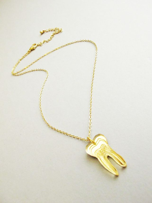 Gold Tooth pendant by Working Clasp
