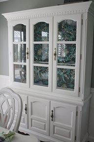 love the wallpaper background inside the china cabinet! super cute!