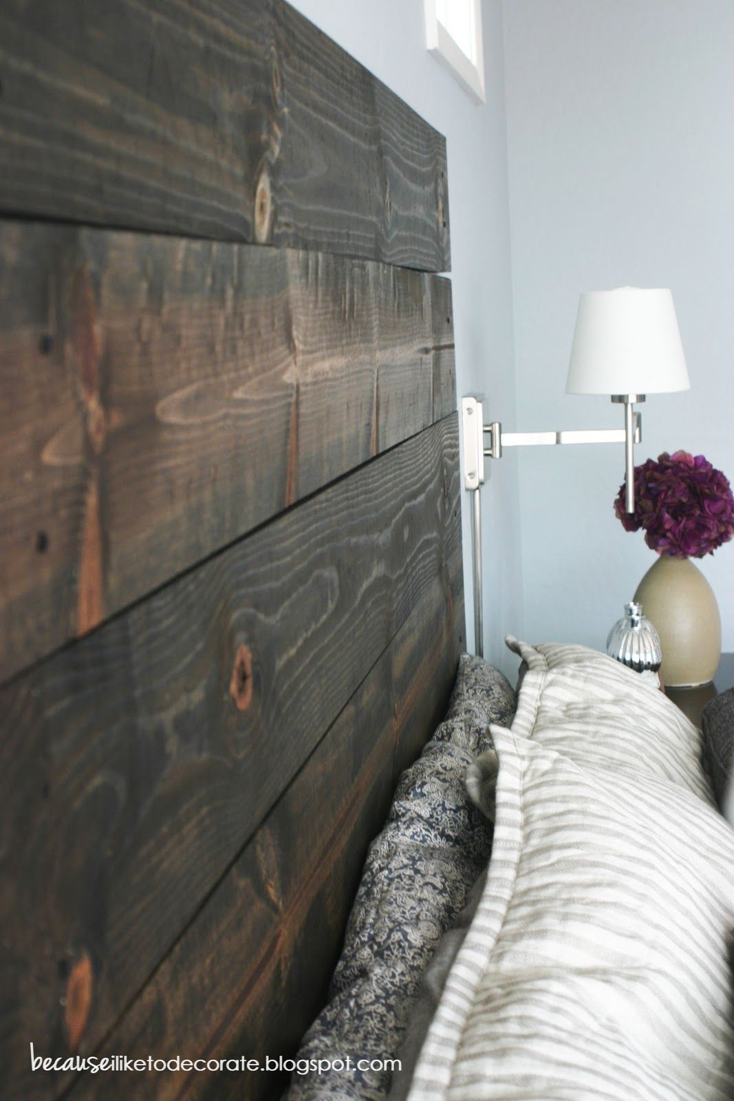 headboard made from 2x4's and stained. each is individually drilled into the wall. Cheap and easy!