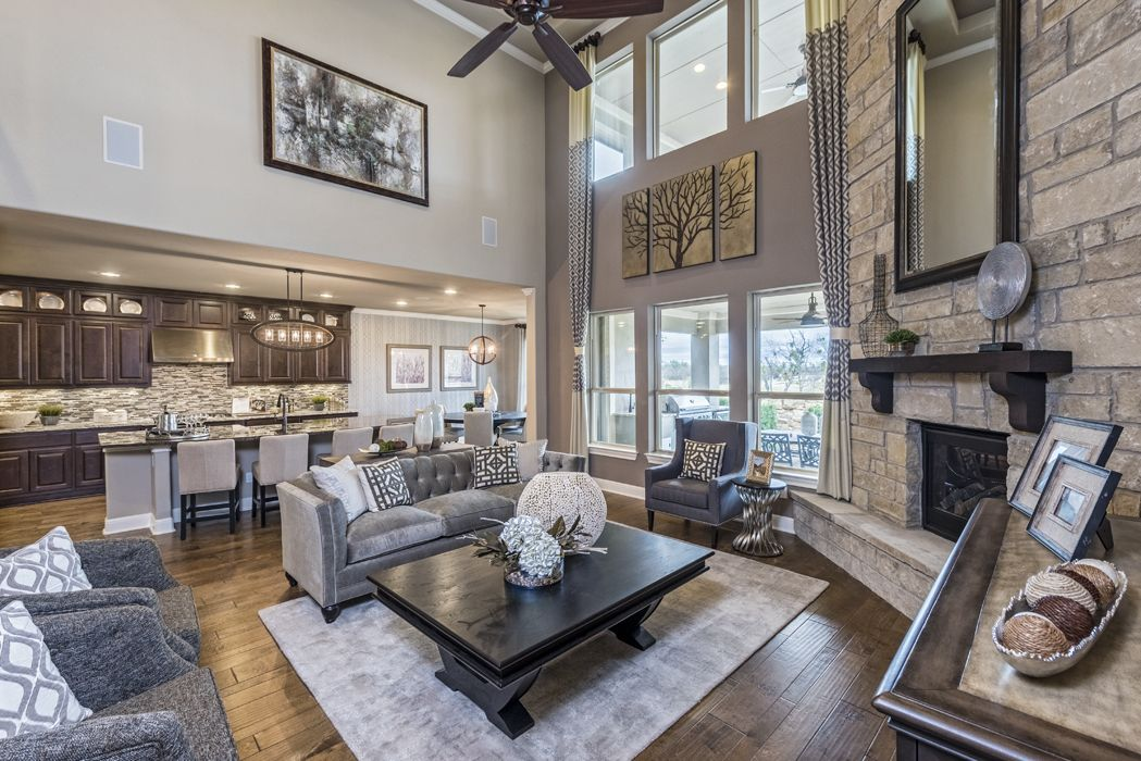 an open concept livingroom with woodfloors and an incredible