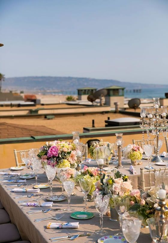 4fe7f71a7c The rooftop wedding reception had a stunning view of the Pacific Ocean.  Callaway Gable. Flowers by Butterfly Floral.