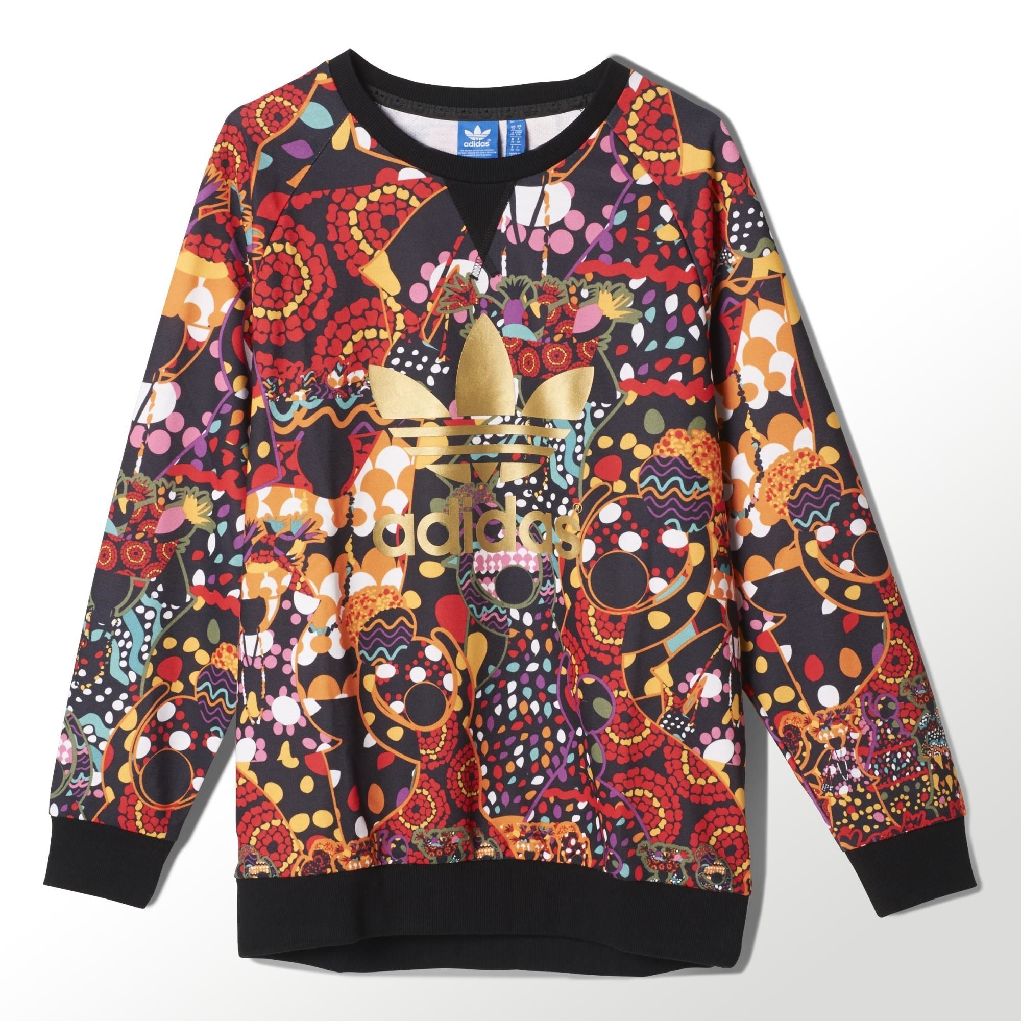 new products f865e 6f948 One of adidas  most iconic styles is the blank canvas for the folk  dance-inspired patterns on the Maracatu Sweatshirt for women.