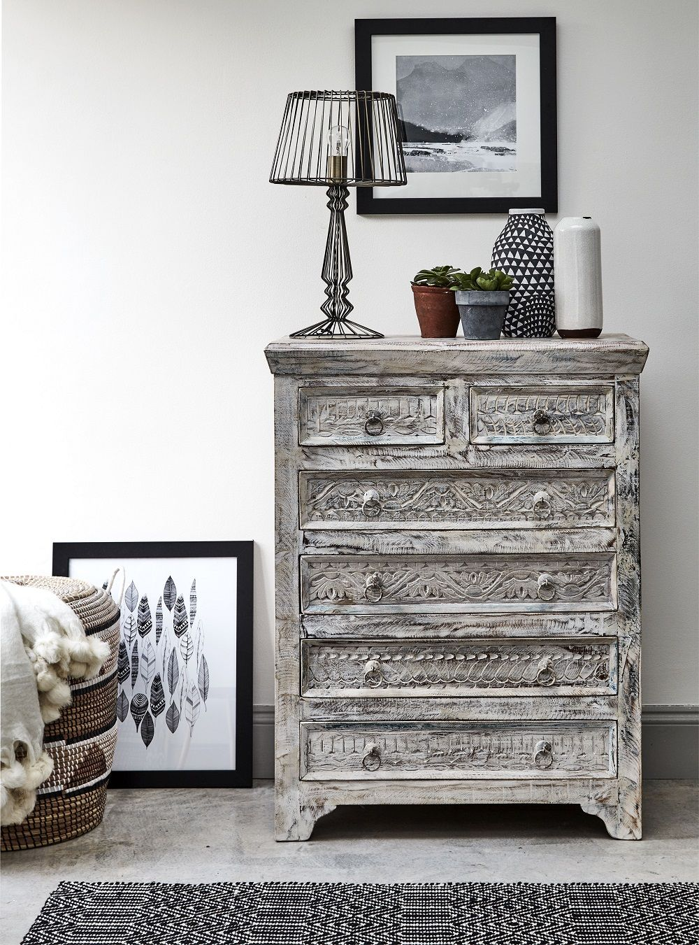 Nordicinspired bedroom furniture and chic monochrome details make