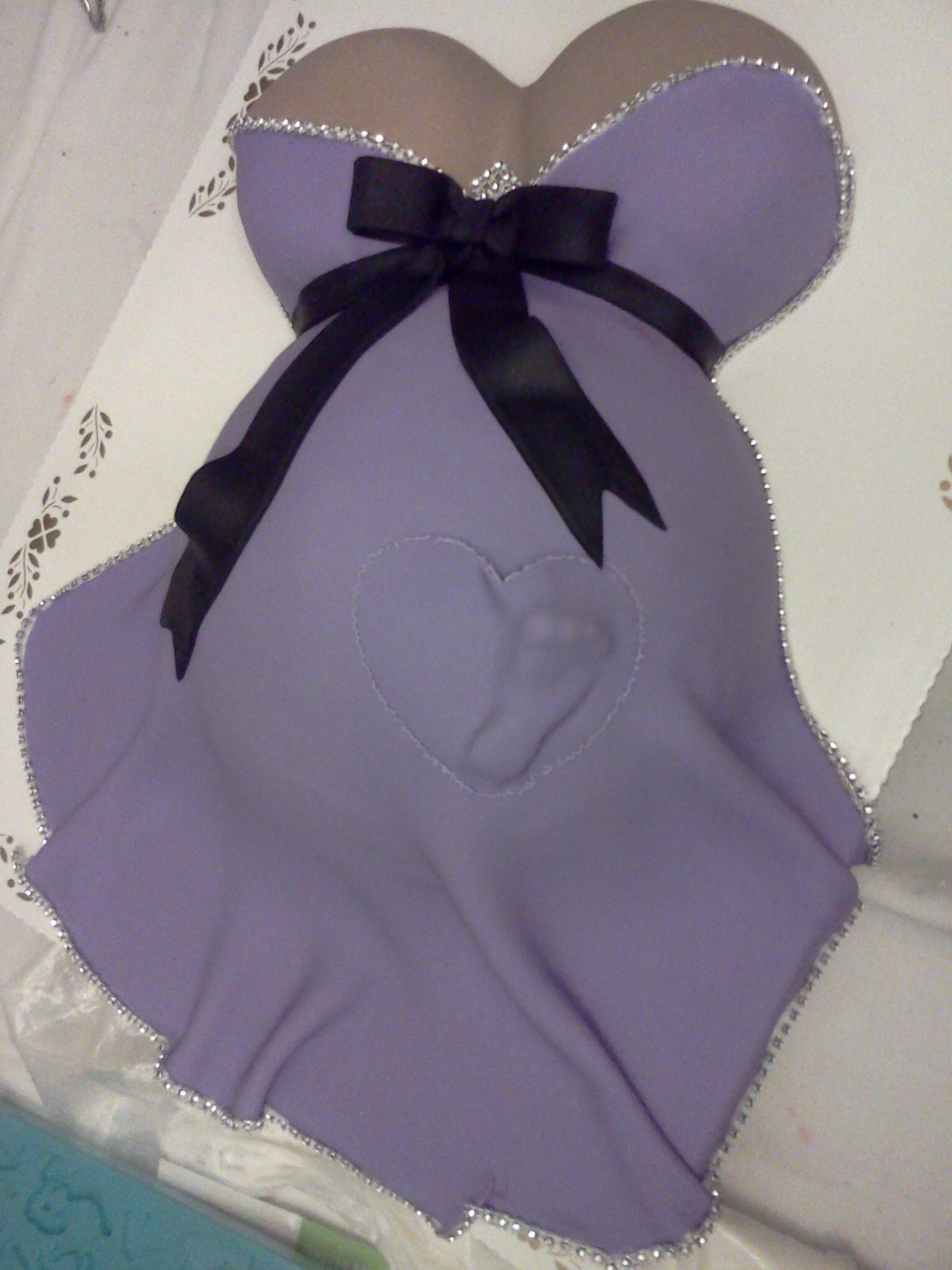 Baby shower pregnant belly cake baby footprint purple dress