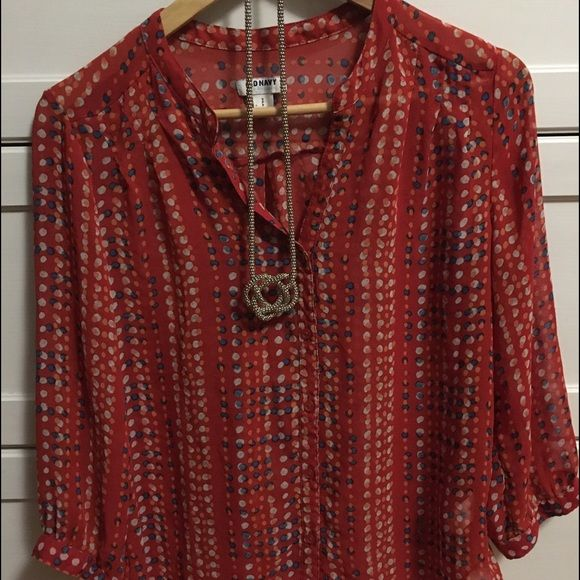Old Navy Button Down Blouse. Red with polka dots. Old Navy Button Down Blouse. Red with polka dots. Sheer, would need tank underneath. Sleeves would be 3/4 or just a tad longer, button detail. Slight pleating around neck area. Reddish/orange in color with orange, blue and heather gray/silver dots. Old Navy Tops Blouses