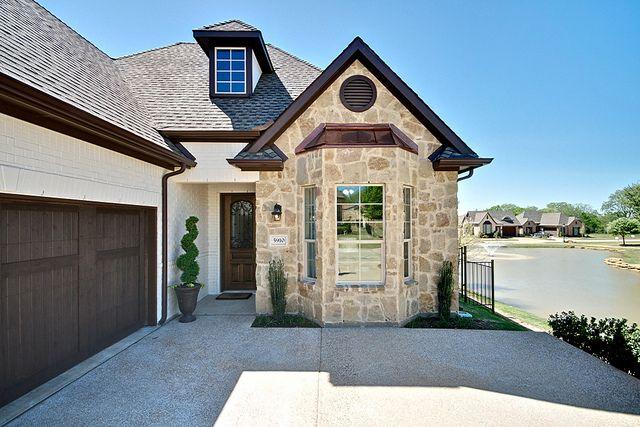 Front 4 brown trim cream paint and garage doors for Dark brown exterior trim