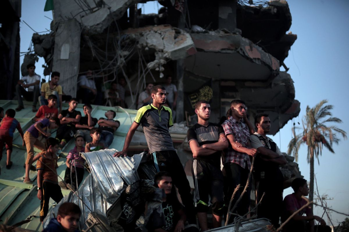 Getty Images 2014 - Palestinian men listen to a press release in Eastern Gaza