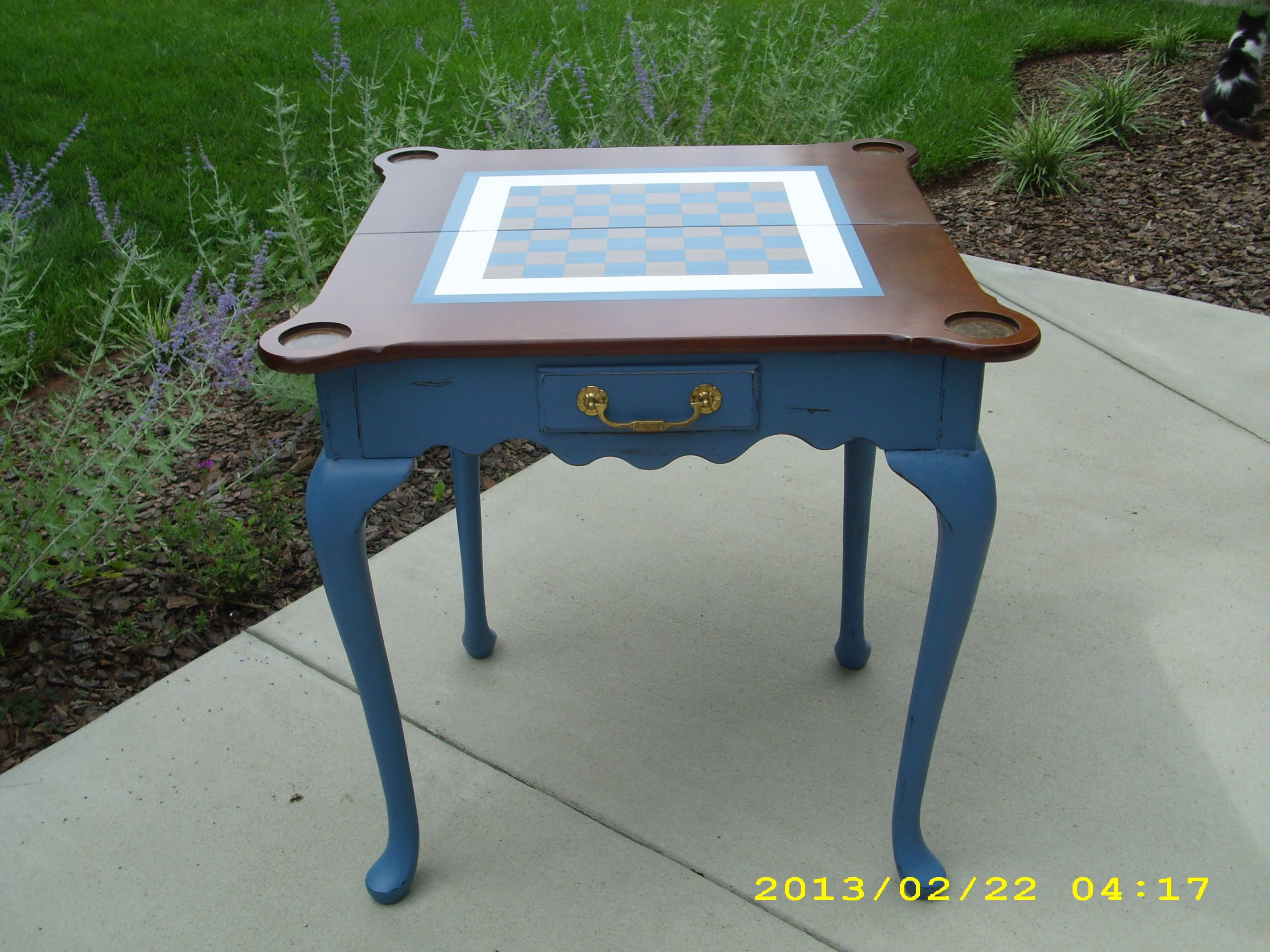 painted checkerboard on top of game table.