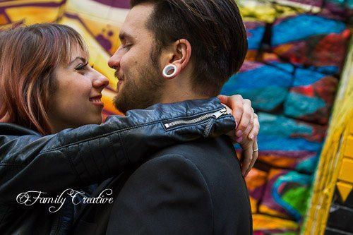 couple photo session | edgy punk musician | engagement photo ideas | graffiti wall | Vancouver BC | leather jackets | stretched ears | in love!