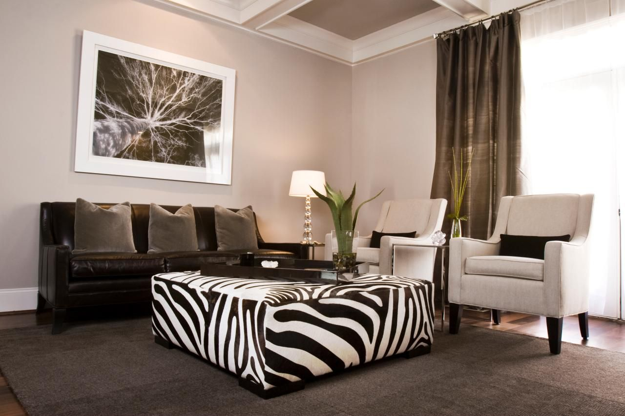 This Trendy Gray Living Room Features A Zebra Print Ottoman Black Leather Sofa And