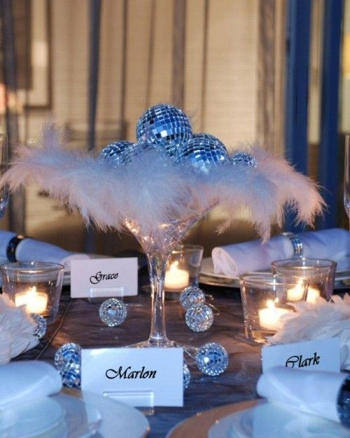 Tablescape feathers and shiny ornaments wedding