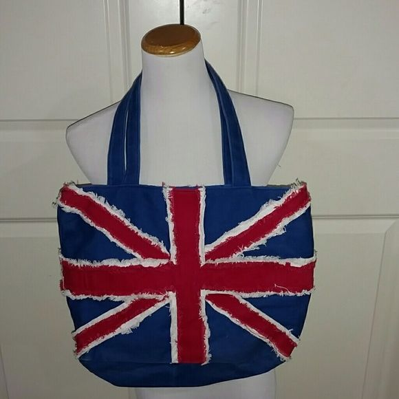 UK Purse Handbag Pre owned and in great condition. UK flag symbol on purse. Zips up on top. Small inside pocket. Bags Shoulder Bags