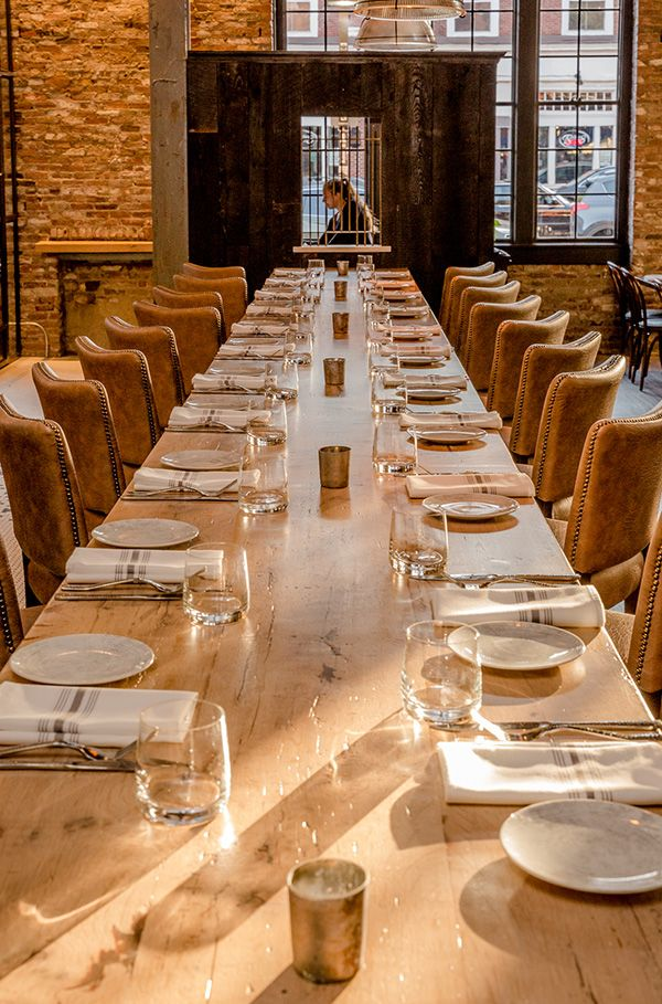 Reclaimed oak restaurant tables were crafted for Ledger restaurant in Salem, Massachusetts, one of impressive 24-foot length and seating 22 customers. Wood from Longleaf Lumber. Photo by Michael Diskin