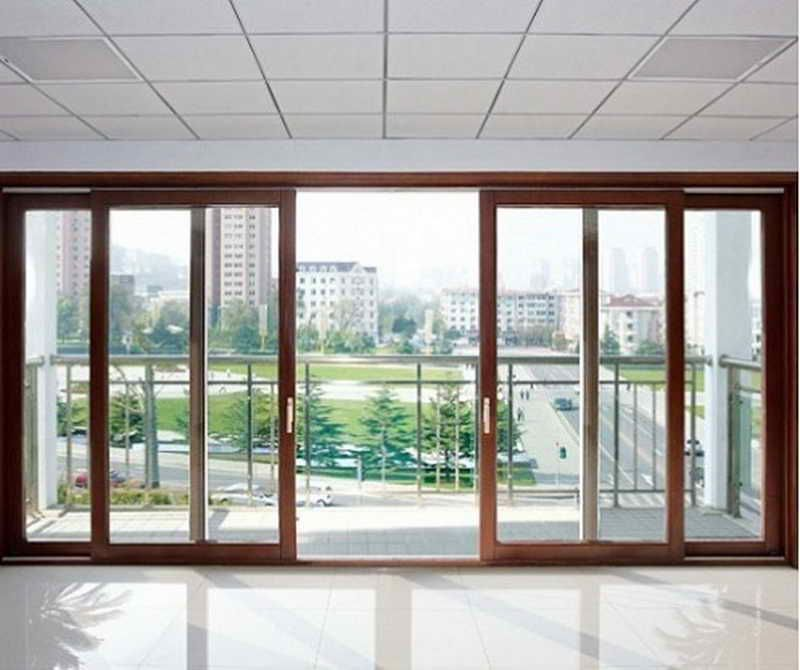 Charming elegant wooden sliding french doors for your for Double sliding patio doors