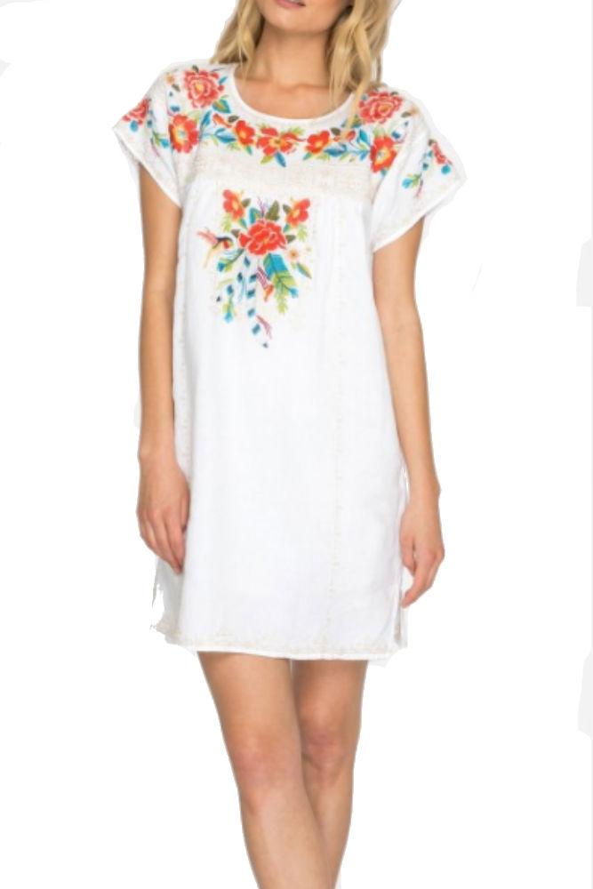 0f4ba36b99 The shift silhouette of the Samira Pleated Tunic Dress makes it a versatile  piece for any body type. The brightly colored floral embroidery along the  ...
