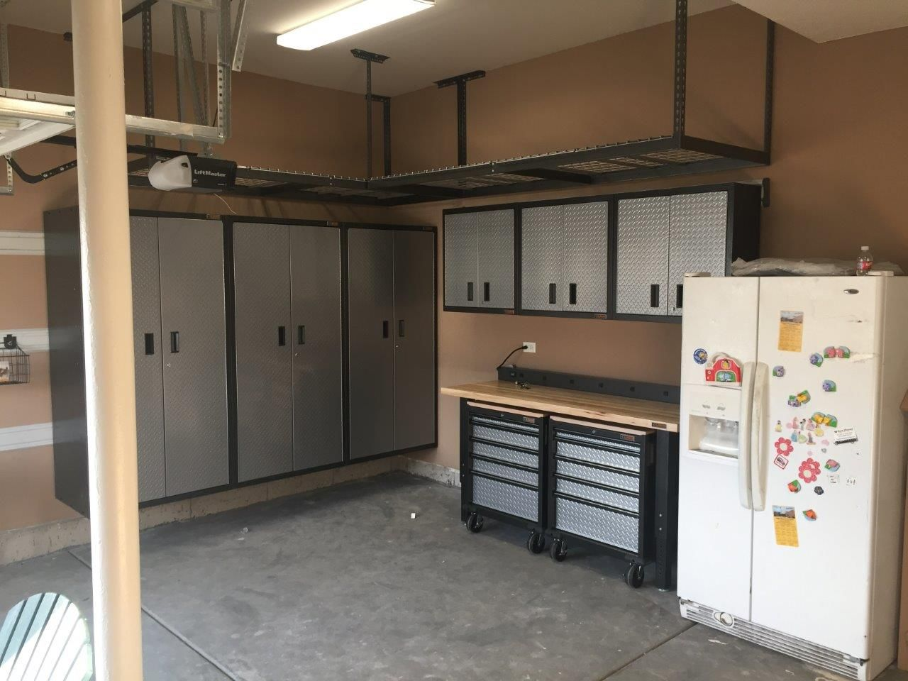 New Garage Set Up   Gladiator Cabinets, Drawers And Several Overhead  Storage Racks To Free Up That Floor Space!