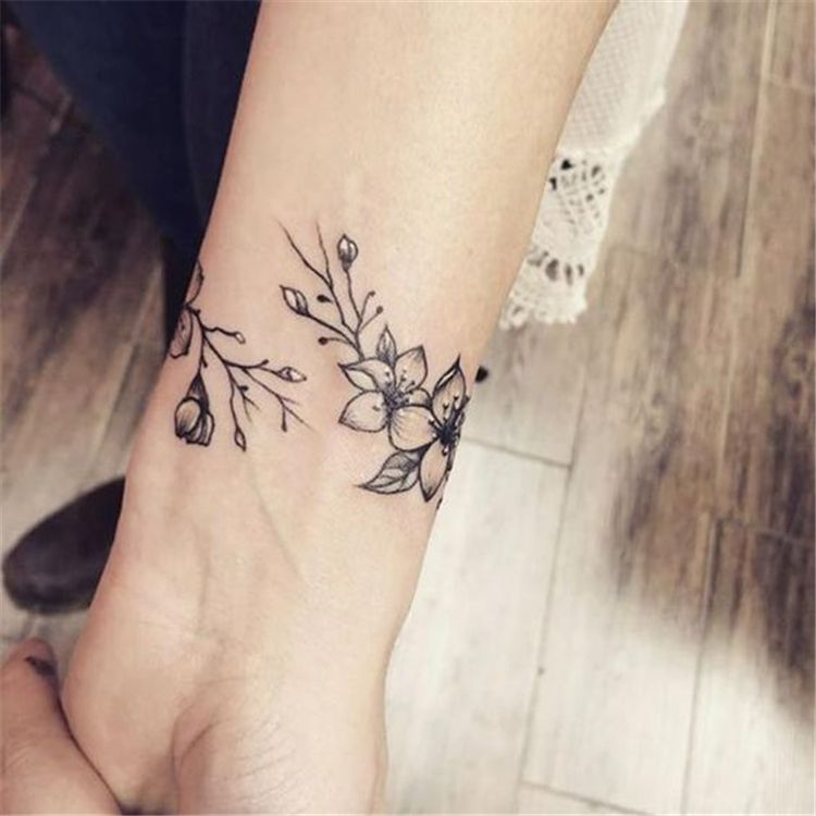 50 Meaningful Wrist Bracelet Floral Tattoo Designs You Would Love To Have Page 46 Of 50 In 2020 Wrap Around Wrist Tattoos Wrap Around Tattoo Wrist Tattoos For Women