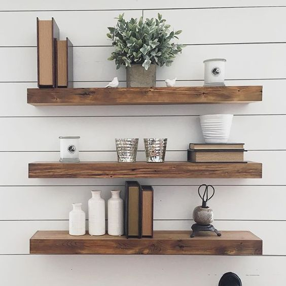 Reclaimed Floating Wood Shelves Thick In Front Of A White Plank Wall