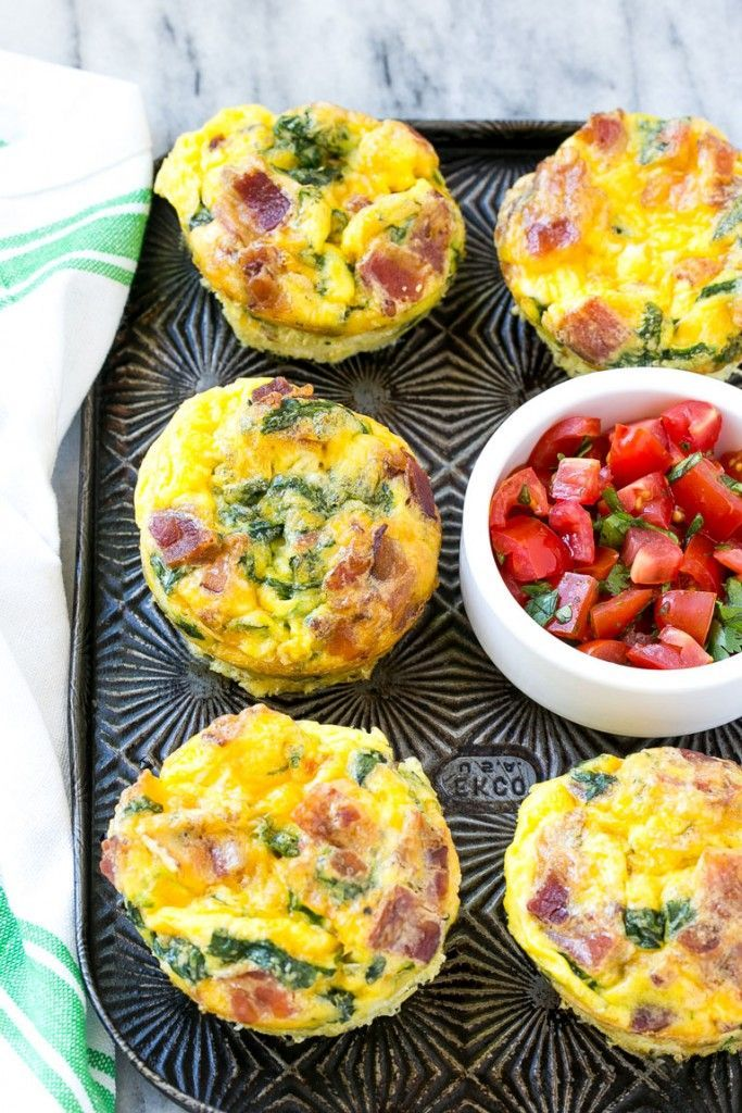 recipe for breakfast egg muffins is an easy grab and go option for busy mornings. The protein packed egg muffins are loaded with bacon, cheddar cheese and spinach for maximum flavor!