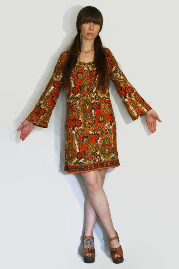 Amazing bright 60s paisley floral bell sleeve dress Handmade It great condition Vintage metal buttons up front Material: Unsure no tag