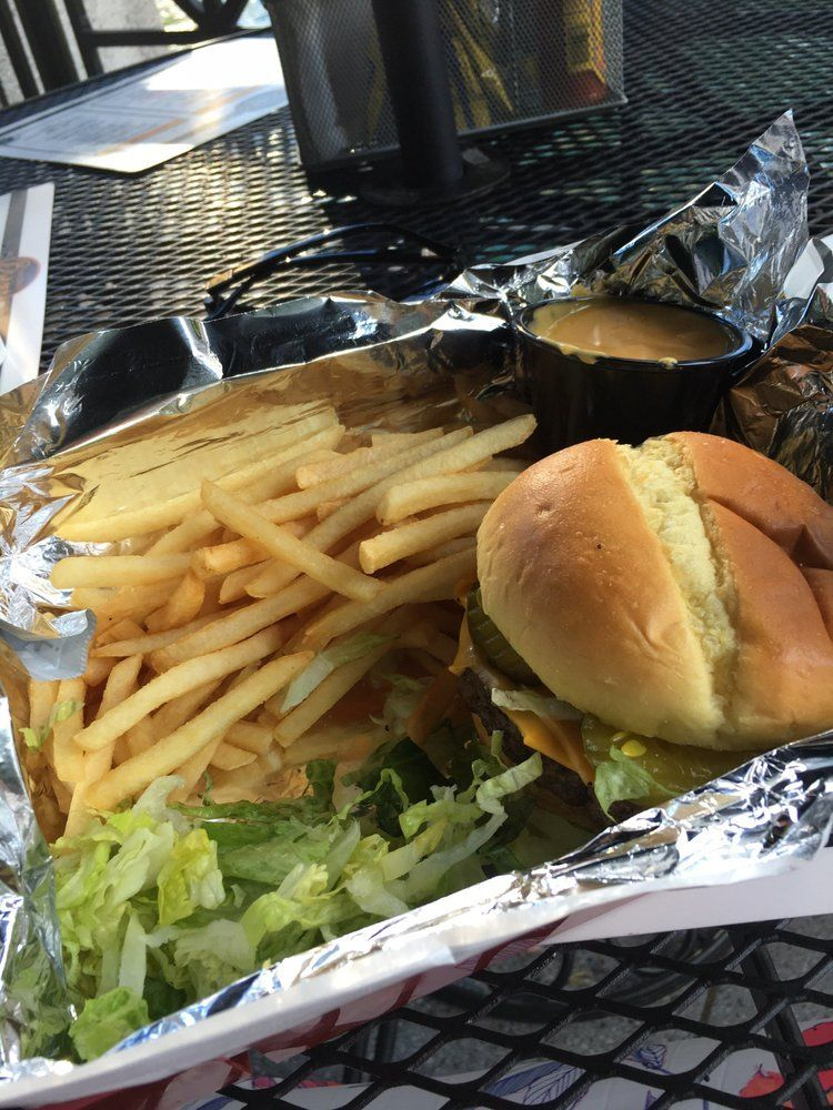 Chicago Burger Company - Chicago, IL, United States. Cheese Burger with cheese fries. I picked off the shredded lettuce