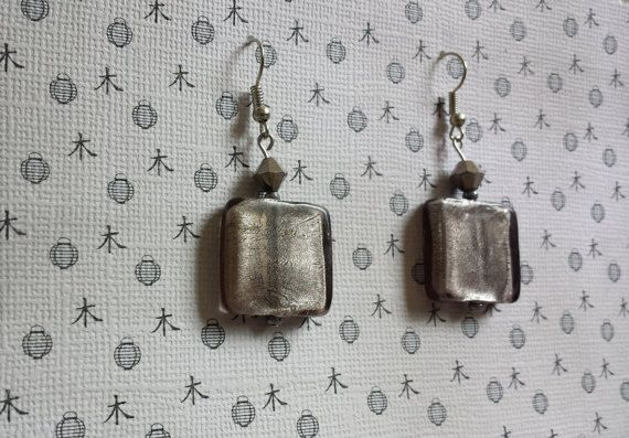 Check out this item in my Etsy shop https://www.etsy.com/listing/238423780/silvery-gray-dangle-bead-earrings