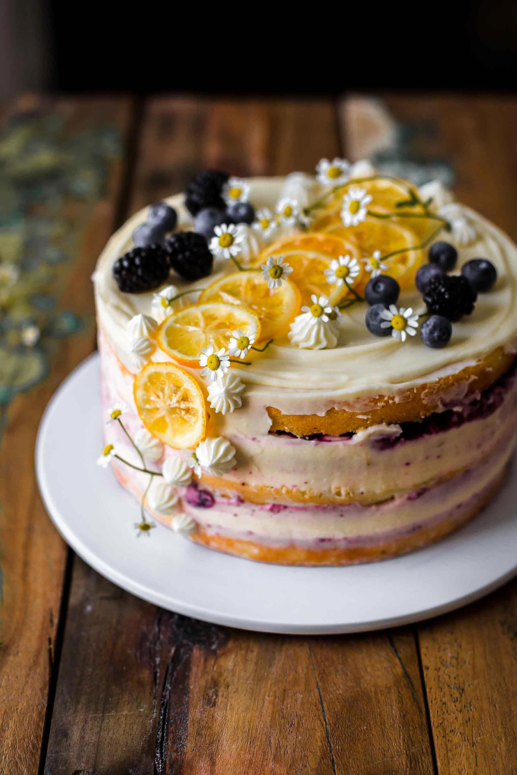 This Lemon Blueberry Cake is tangy sweet super moist and creamy Its a delicious and beautiful cake It comes with soft lemon cake layers a sweet blueberry filling and an u...