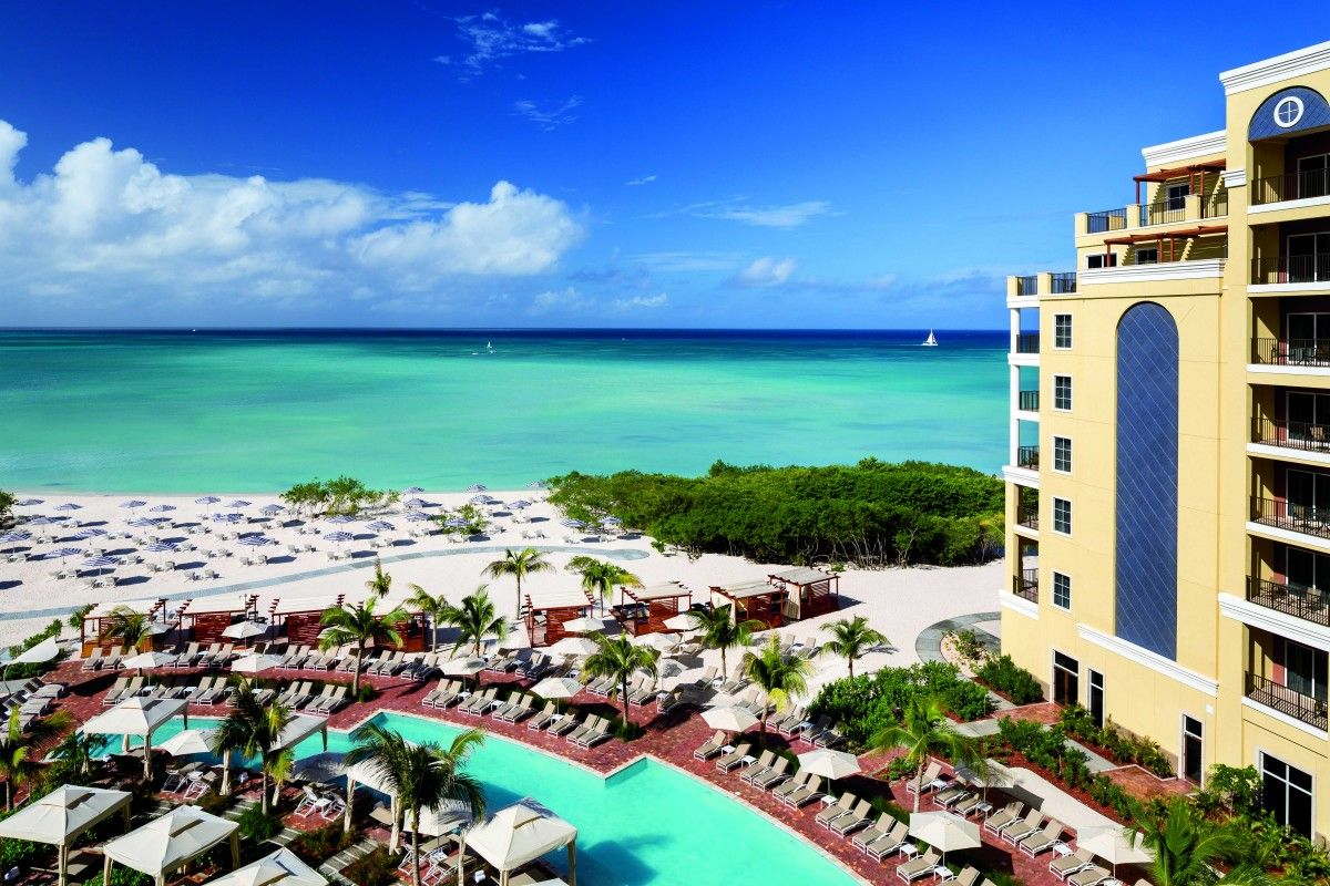 Experience the many remarkable resort offerings of the ritz carlton aruba one of the premier luxury hotels on the islands famed palm beach