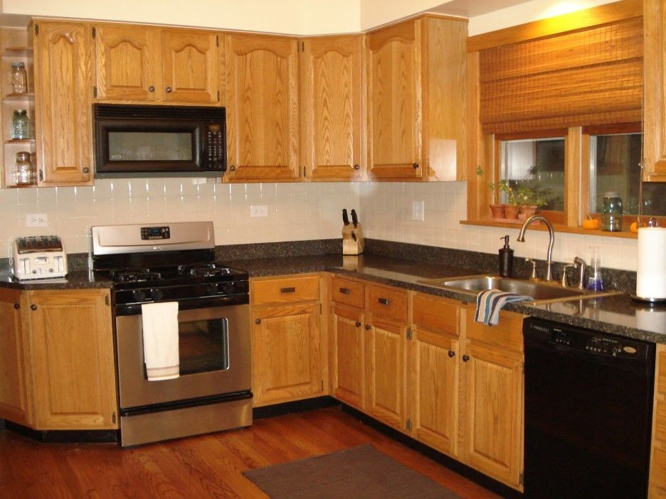 Kitchen. brown oak kitchen cabinet connected by black ... on What Color Cabinets Go Best With Black Granite Countertops  id=46328