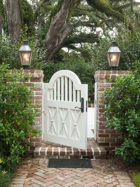 I know this is just a gate, but the white and the brick and the lights and the bushes are all exactly the LOOK that I love.