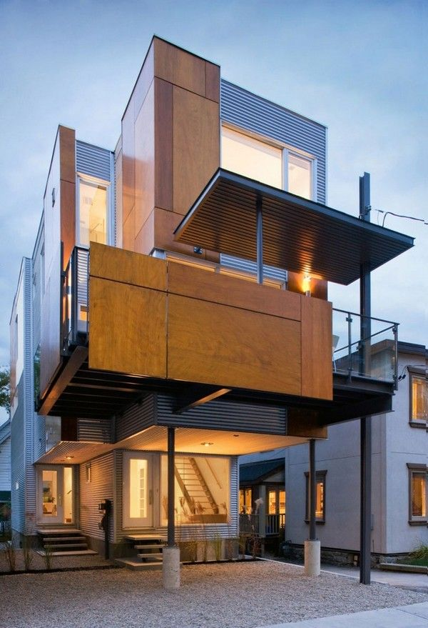 Contemporary Building Hosting Two Functionally Separate Homes in ...