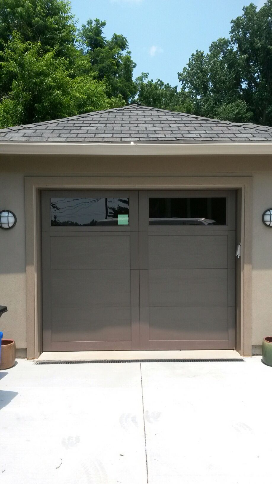 Steel And Composite Overlay Bronze Color Garage Door In Bethesda Md By Crisway Garage Doors Garage Doors Residential Garage Doors Steel Garage Doors