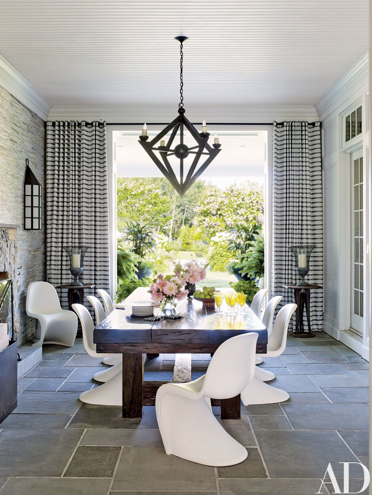 Verner Panton Chairs By Vitra Join A Chandelier Jerry Pair On An Enclosed Porch