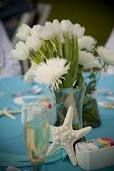 Starfish and white flower beach wedding centerpiece, agua blue and white color scheme