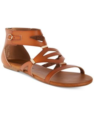 79ca1dee8df7 Shop for Sandals online at Macys.com. Take your look on exotic vacations  and fun weekend festivals in the caged strappy design of these Neves  gladiator ...